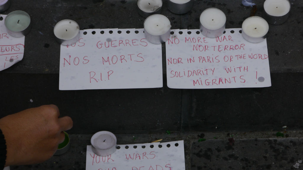 A note at the Place de la Republique reads: 'No more war, nor terror nor in Paris or the world, solidarity with migrants!'