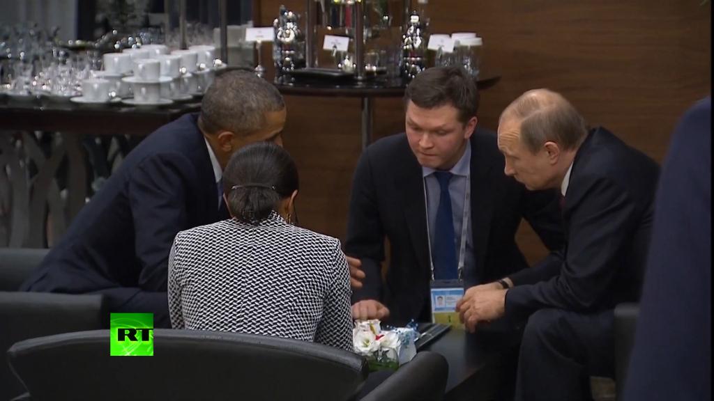 Mr Obama and Mr Putin speak with advisers after the Paris terror attacks.