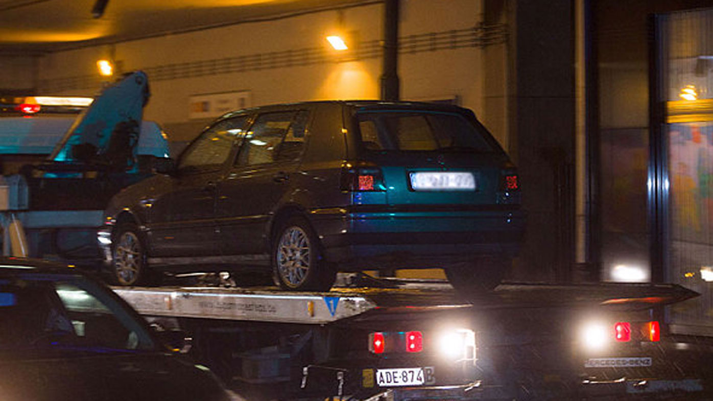 A VW Golf seized by police in Belgium is towed away.