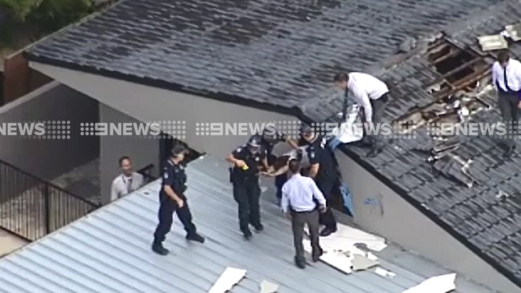 Police have arrested a man hiding in a roof in relation to the stabbing death of a Gold Coast teenager. (9NEWS)