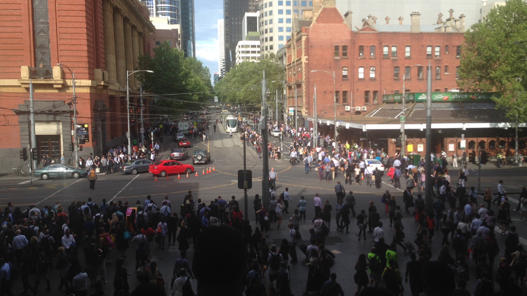 Commuters spilled down the walkway onto Spencer and Bourke Streets. (Mike Hurley)