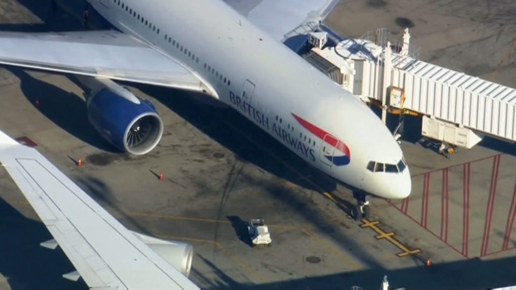 A woman has been restrained after allegedly attempting to open the exit door on a flight to Boston from London. (Supplied)