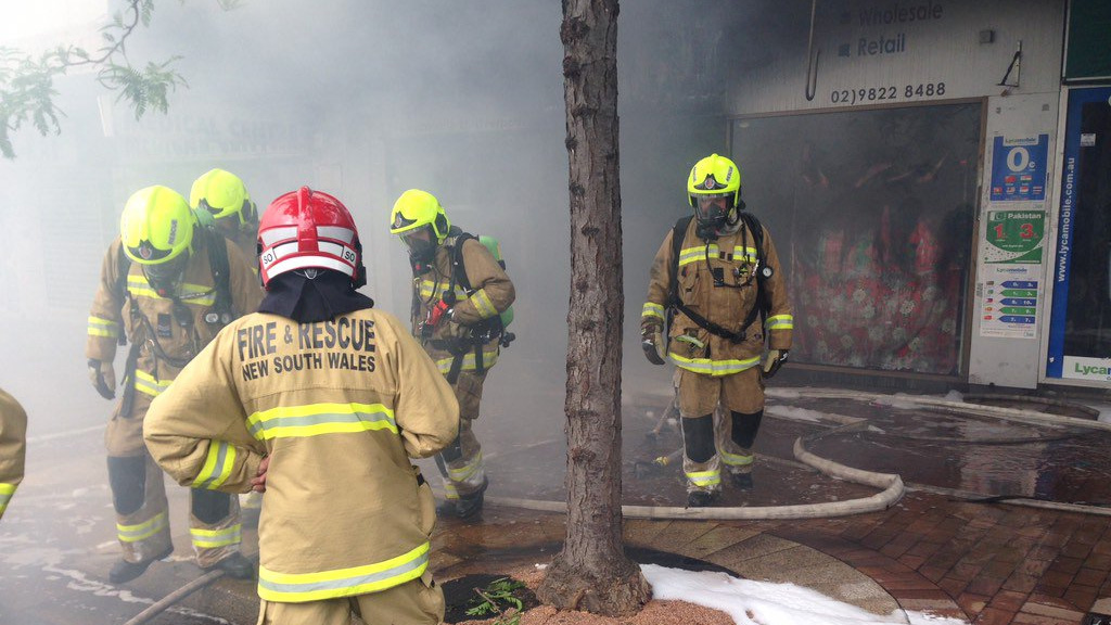Firefighters have contained the Liverpool shop blaze that had spread to three other businesses. (FRNSW)