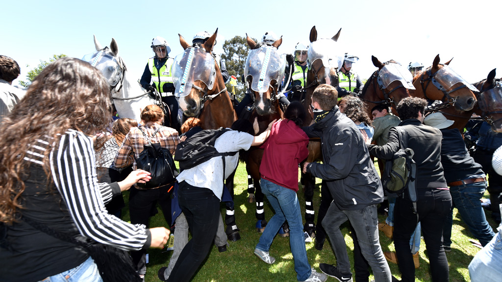 Protesters clash with police horses. One man was arrested for allegedly punching a horse. (AAP)