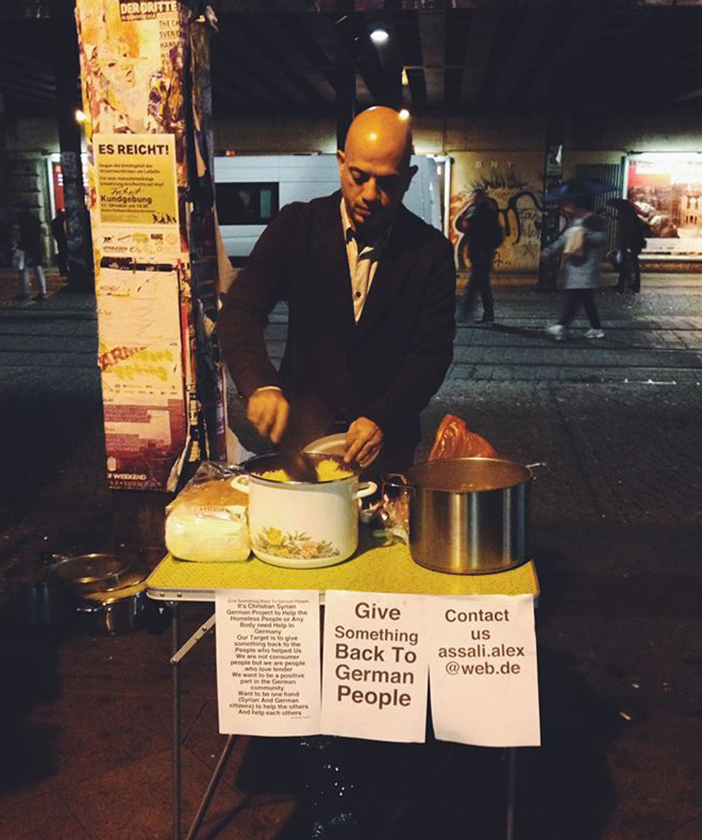 Viral News From Germany: Syrian Refugee Pictured Feeding Homeless Germans In Viral