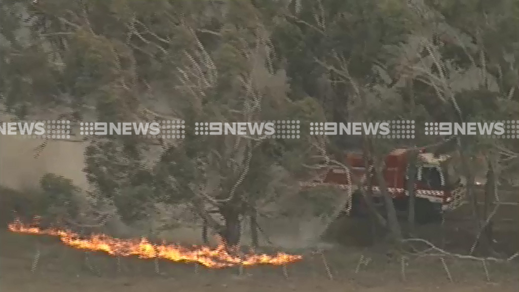 Firefighters are battling spot fires that have flared up away from the main blaze. (9NEWS)