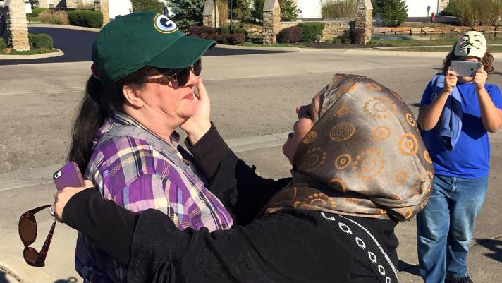 Muslim woman defuses anti-Islam rally outside mosque by giving protester a hug