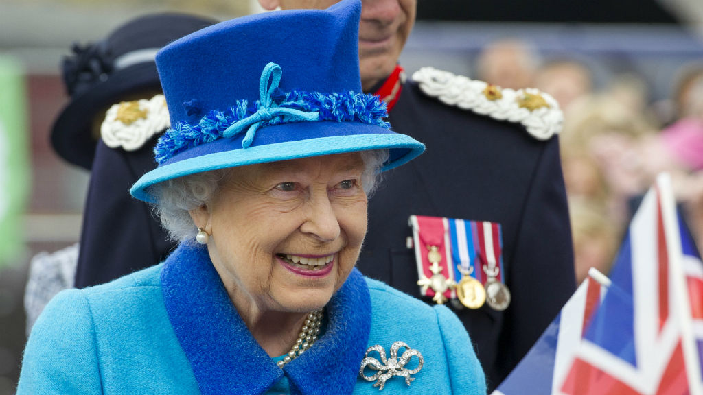 Queen Elizabeth II greets well-wishers as she opens Newton Grange railway station.