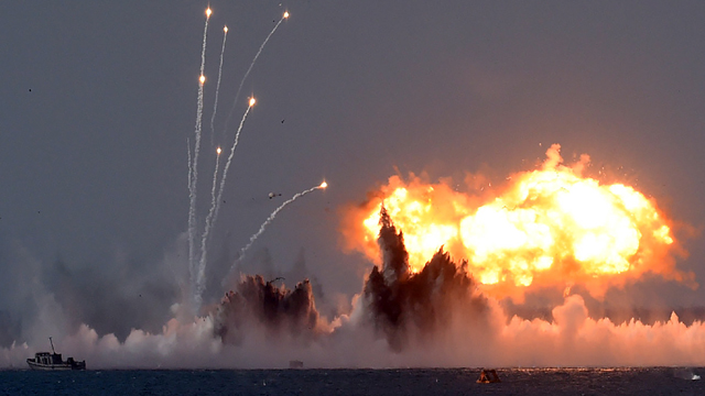 Russia's military jets and navy ships combine to light up the sky off the Crimean coast. Source: AFP