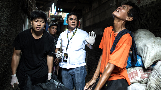 The grieving father of a suspected drug user killed by the police in Manila. Two were captured alive, one died. Source: AFP