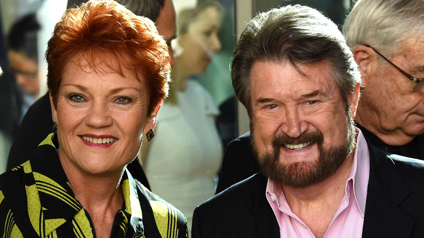 One Nation Senator Pauline Hanson with Senator Derryn Hinch pose for a photo before an induction for new senators at Parliament House in Canberra.