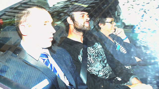 Marcus Stanford (centre) arrives at the Sydney Police Centre after being extradited from South Australia by NSW Police, Sydney, Thursday, June 11, 2015