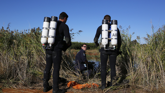 Members of the police dive unit prepare to search an irrigation channel for the body of teacher Stephanie Scott on the outskirts of Leeton, in the NSW Riverina, Friday, April 10, 2015