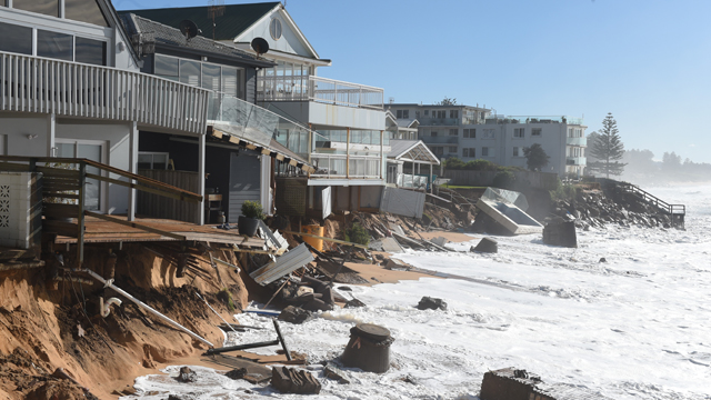 Homeowners in Collaroy watched as hundreds of thousands of dollars were wiped off their property value by huge June storms. Source: AAP