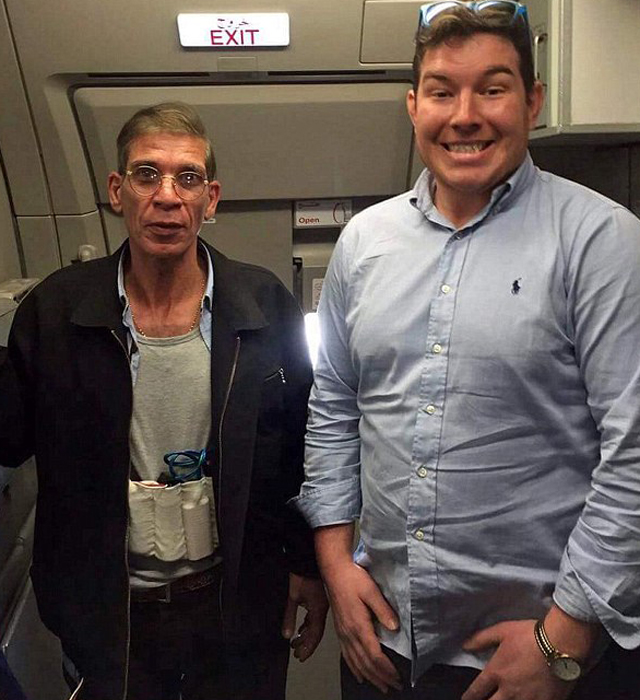 British man Ben Innes, 26, poses with the hijacker on board an EgyptAir flight