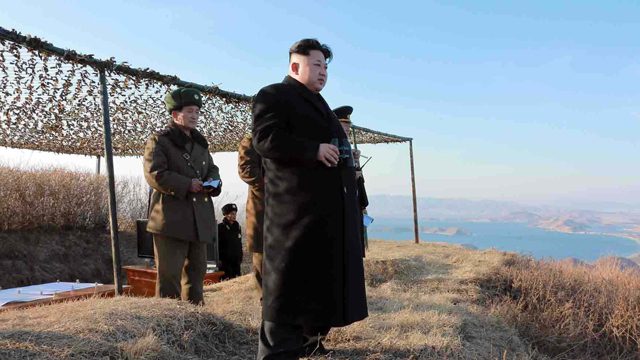 North Korean leader Kim Jong-Un inspects a large-caliber multiple rocket launching system