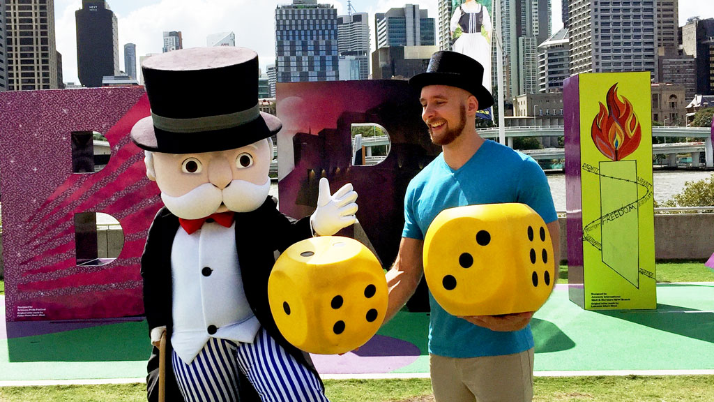 Mr Monopoly with current Australian Monopoly champion and Brisbane resident Tony Shaw at the launch of a new Brisbane version of the game. (AAP/A Little Extra)