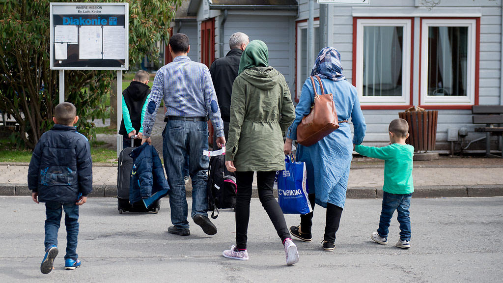 Refugees from Syria arrive at the Friedland shelter near Goettingen, central Germany, on April 4, 2016, after arriving from Turkey at the airport in Hanover. (AFP)