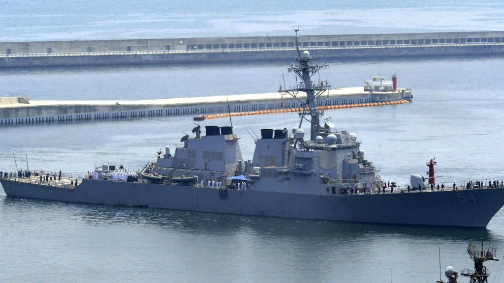 China condemns US for sending warship into disputed sea