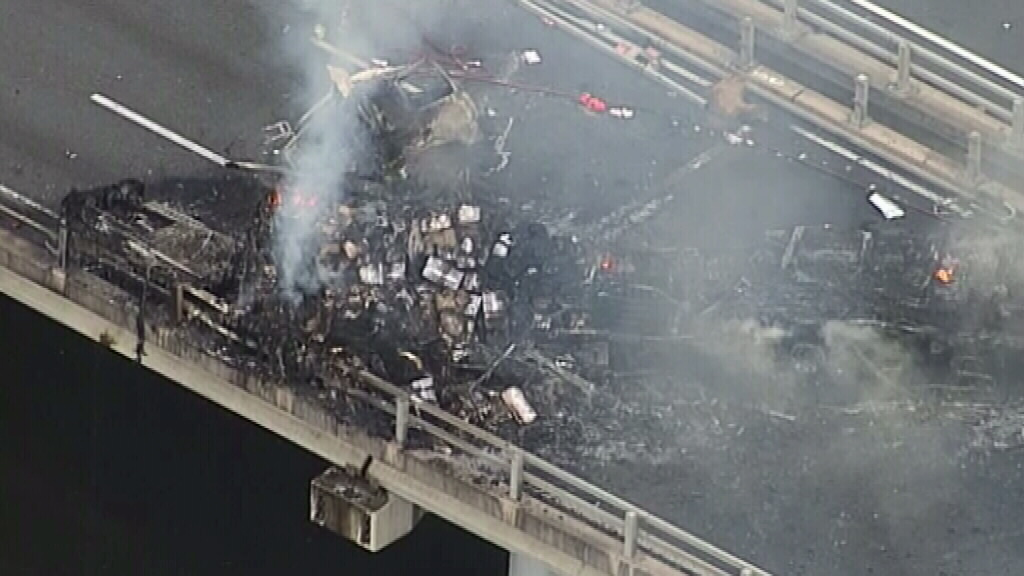 All that remains of the truck is a fiery wreck. (9NEWS)