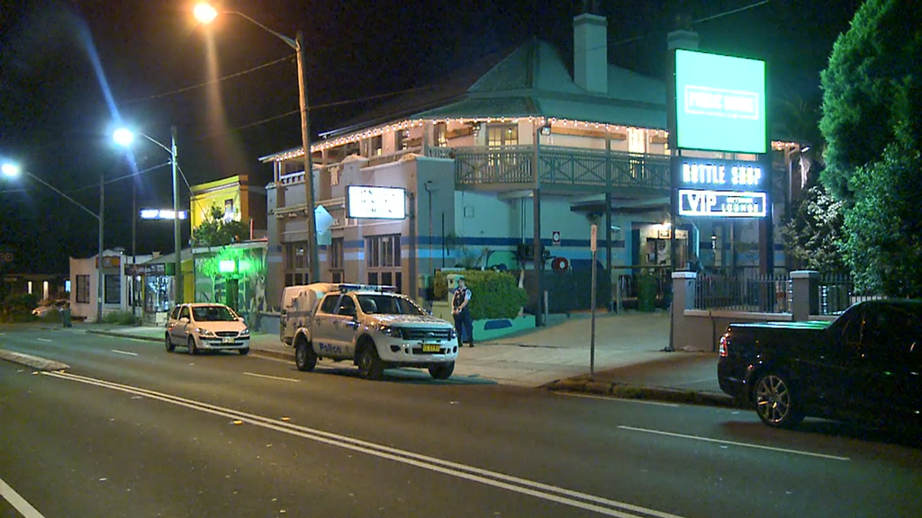 Three men are on the run after holding up a Sydney hotel with an axe and machete. (9News)