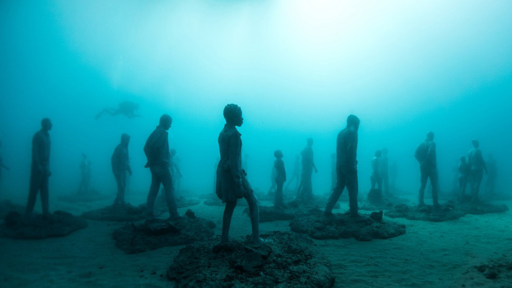 "A new underwater museum featuring the artwork of British sculptor James DeCaires Taylor is set to open later this month in the Canary Islands, off the coast of West Africa.<br /><br />Located 14 metres beneath the sea off the island of Lanzarote, Museo Atlantico contains multiple installations, including one which references Europe's current refugee crisis.<br /><br />""The work is not intended as a tribute or memorial to the many lives lost but as a stark reminder of the collective responsibility of our now global community,"" Taylor wrote in a statement on his website.<br /><br />The museum is not expected to be completed until January 2017.<br /><br /><strong>Click through to see more surreal underwater artworks.</strong>"