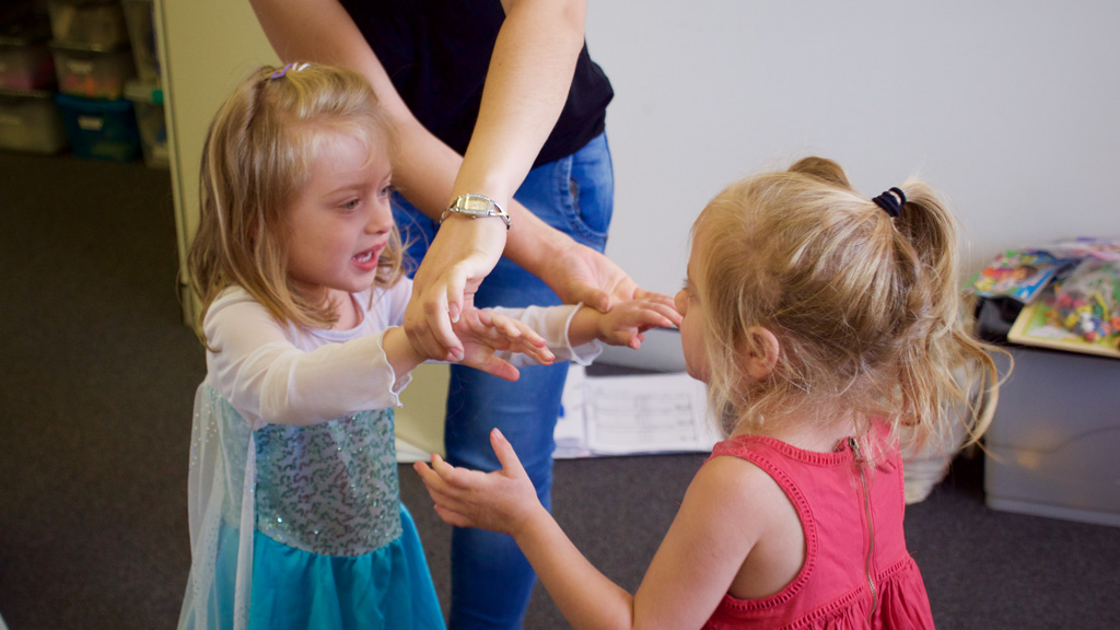 The twins are being taught how to physically interact with each other. (Ehsan Knopf/9NEWS)