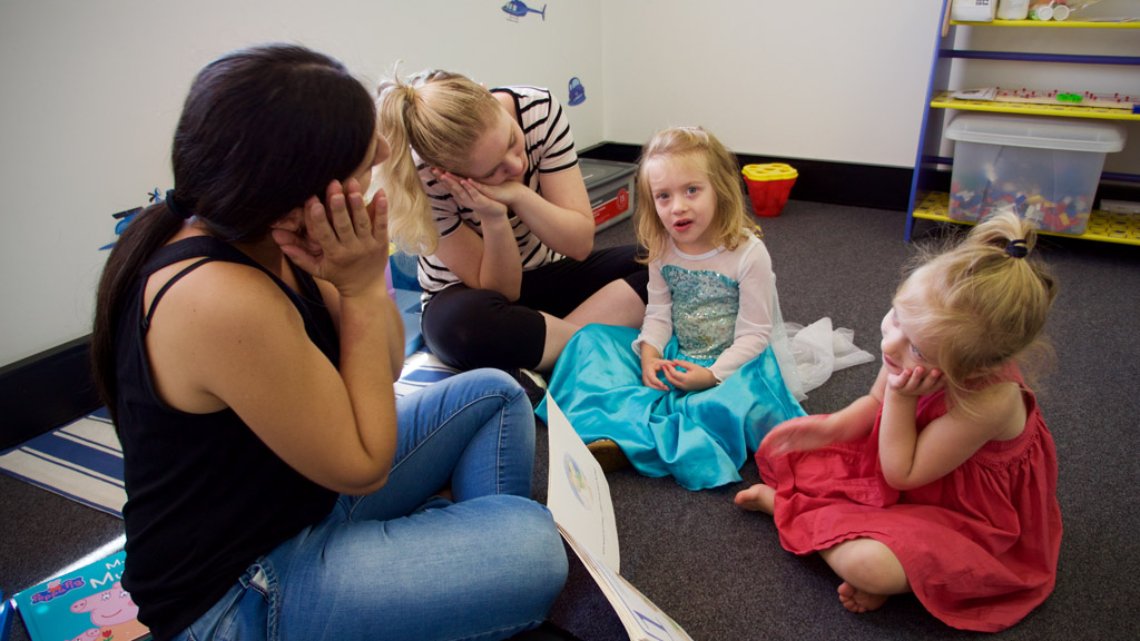 The girls are encouraged to physically respond to the story. (Ehsan Knopf/9NEWS)