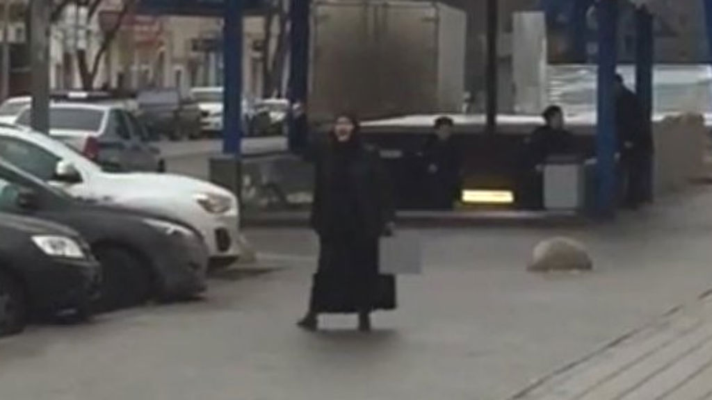 The woman was seen with the severed head outside a Moscow metro station.