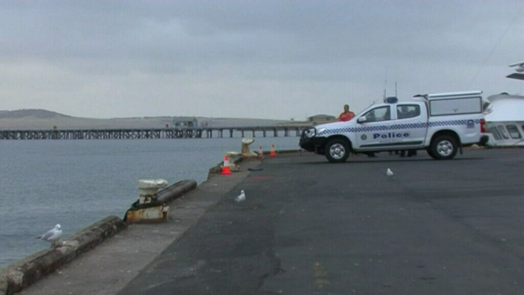 Police at the scene in Brennan's Wharf in Port Lincoln. (9NEWS)