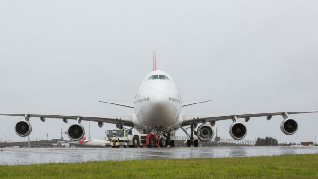 Qantas 747 takes off from Sydney with extra engine on wing