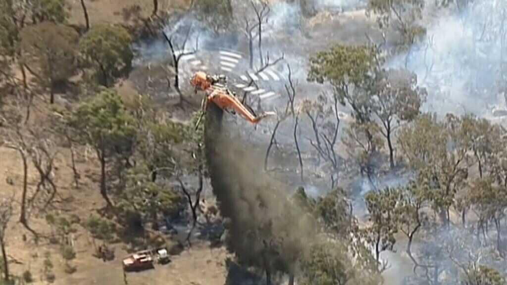Waterbombing aircraft are assisting efforts to fight the fire. (9NEWS)