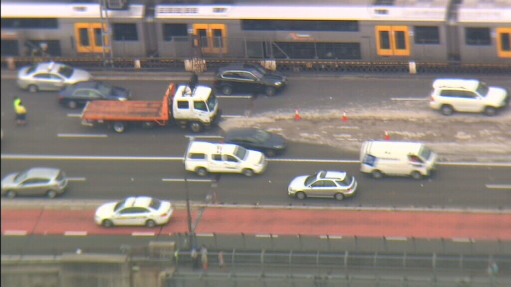 Dirt and gravel spread across the bridge. (9NEWS)