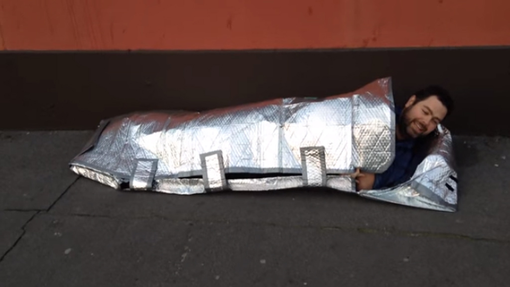 The Journal puts Ms Duffy's sleeping bag to the test. (YouTube/TheJournal.ie)