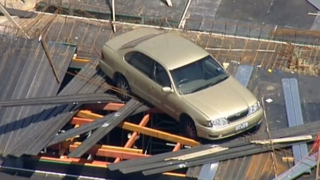 The car was left resting on scaffolding two stories high. (9NEWS)