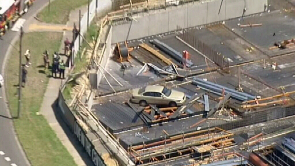 Car perched on scaffolding after crashing into construction site in Burwood East, Melbourne