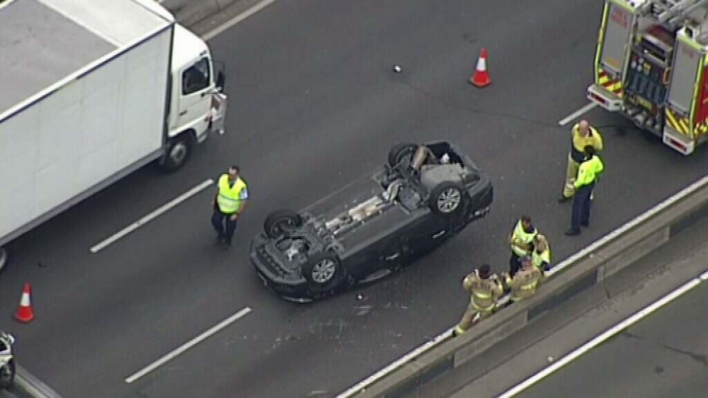 Significant delays on Sydney's M4 at Clyde after car flips onto roof during crash