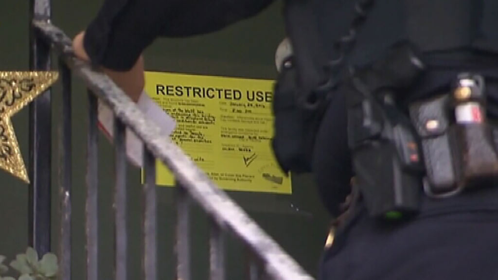 Police have posted notices on the doors of homes along the cliff's edge ordering residents to move