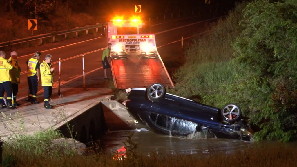 Two charged after car driven into creek following alleged high-speed chase in Sydney's west