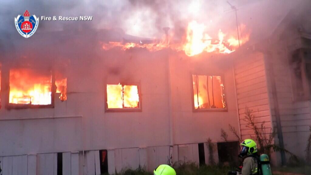 Firefighters battle the blaze in Lakemba. (Supplied)
