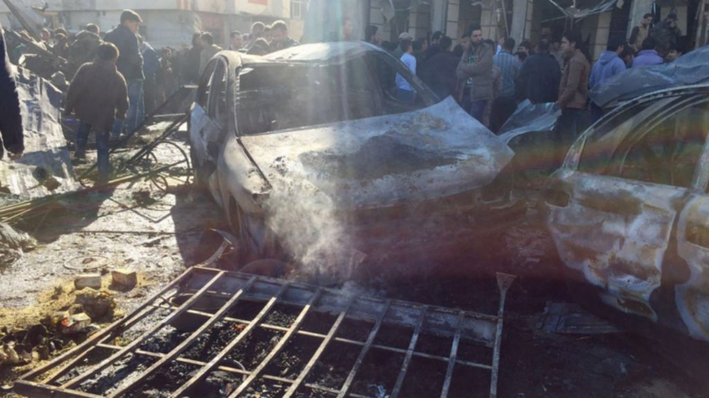 At least 60 people killed in twin blasts in Syrian capital of Damascus