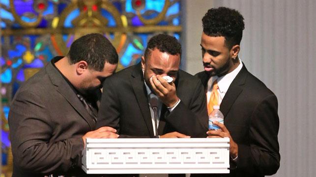 Sons Michael Marquez, Isaiah Henderson and Robert Presley grieve during the funeral of Pulse shooting victim Brenda Lee Marquez McCool. (AAP)