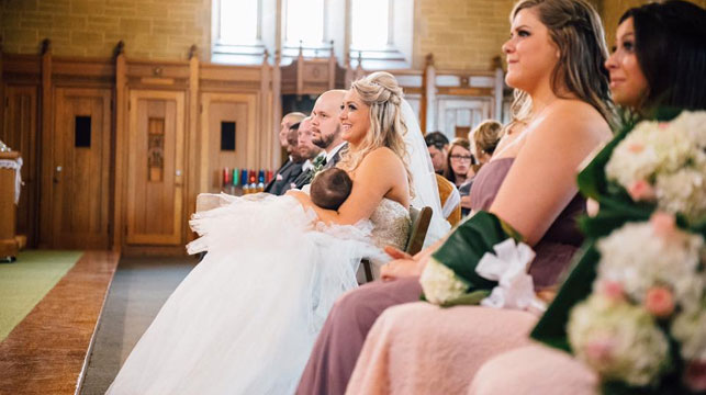 Bride mum becomes viral star for stopping wedding to breastfeed