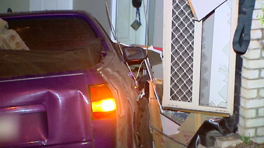 Driver injured after car plunges through fence and into home at Pacific Pines on the Gold Coast