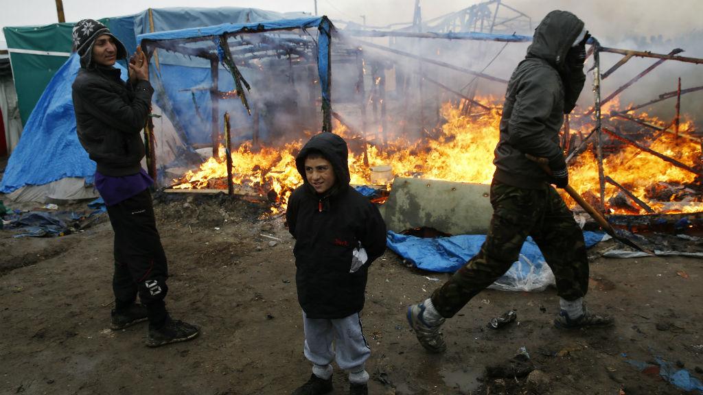 Migrants protest amid camp demolition at Calais jungle