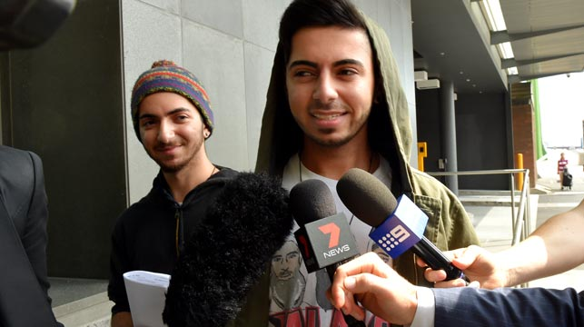 Max and Arman Jalal outside  a Melbourne police station after their arrest. (AAP)