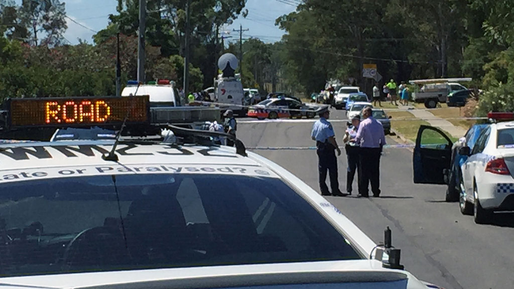 Police officers at the scene of the Riverstone standoff. (AAP)