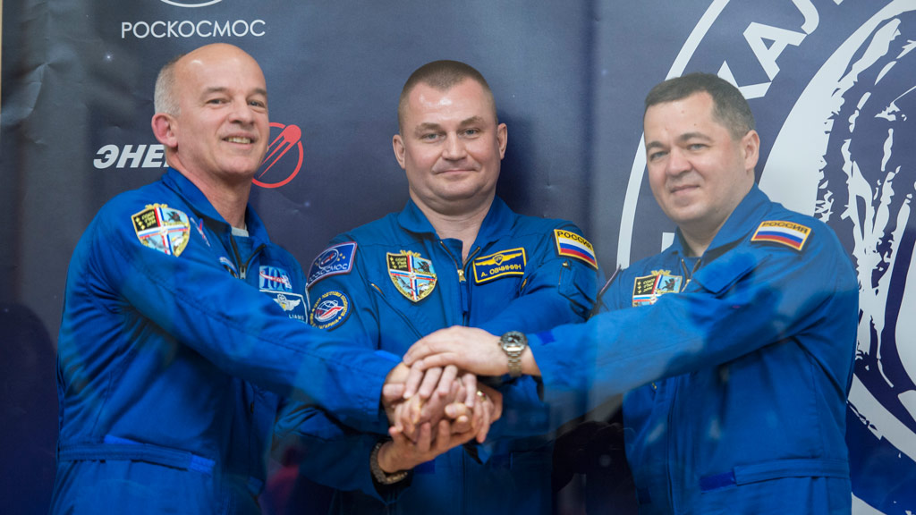 Russian spacecraft carrying US grandfather set to break space travel record docks at International Space Station
