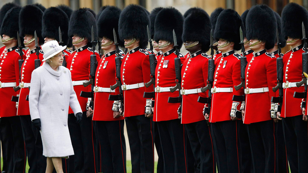 Queen Elizabeth II And The Duke Of Edinburgh Present Colours To 1st Battalion And 7 Company The Coldstream Guards in May 2012. (Getty)