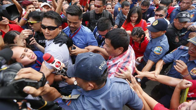 Duterte being mobbed on election day. (AAP)